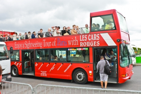 PARIS, FRANCE - JULY 10:Tourists bus in the heart of Paris on July 10, 2012. Paris is one of the most visited cities in the world.