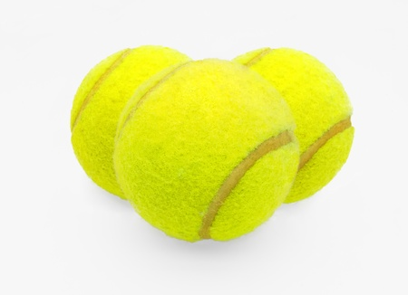 Three tennis balls on a white background Stock Photo