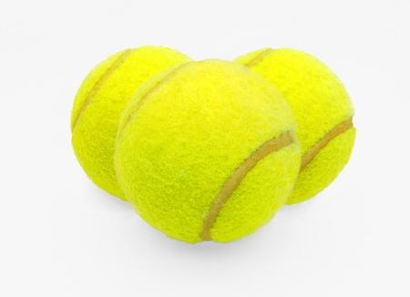 Three tennis balls on a white background Stock Photo