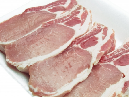 Pork chops packed in a container