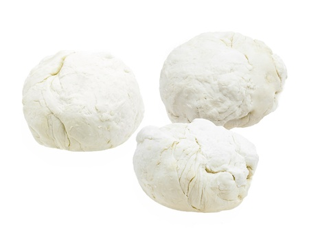 Three pieces of dough on a white photo