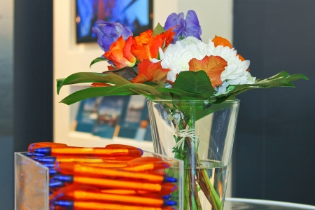 Gift pens and flowers in the interior of office photo