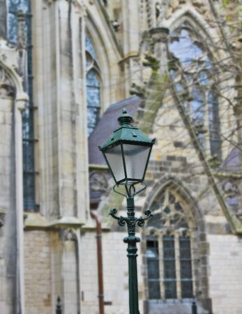 Street lamp on the background of the church photo