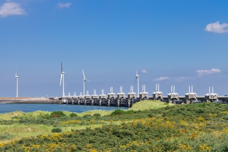 Wind turbines near the storm barrier. Netherlands photo