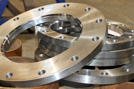 New flanges in the workshop of the plant photo