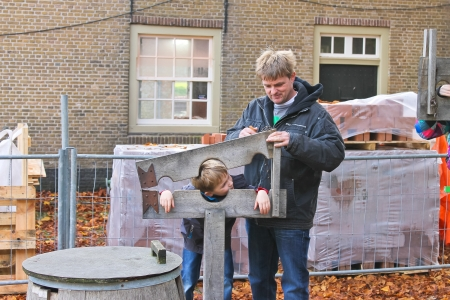 Father shows his son device pillory in the Dutch suburb. Netherlands