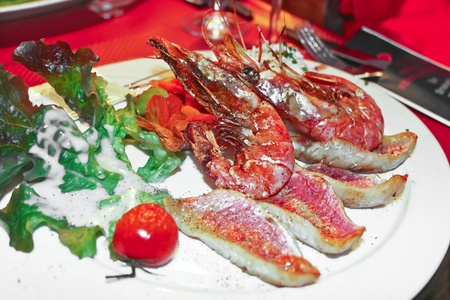 Dish of shrimp and grilled fish in a restaurant Stock Photo - 17679775