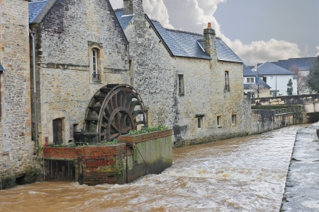 Old mill on river in the town of Bayeux  Normandy, France photo