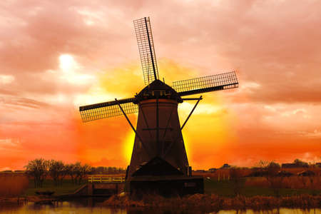 Windmill at sunset. Dutch landscape photo