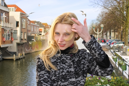 dutch girl: Girl on the waterfront in the Dutch town of Gorinchem. Netherlands