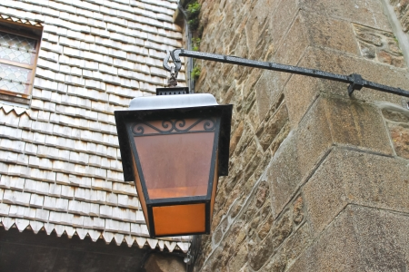 Lantern on the facade of old French house  photo