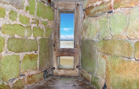 embrasure: View from embrasure of the fortress of Mont Saint Michel. Normandy. France