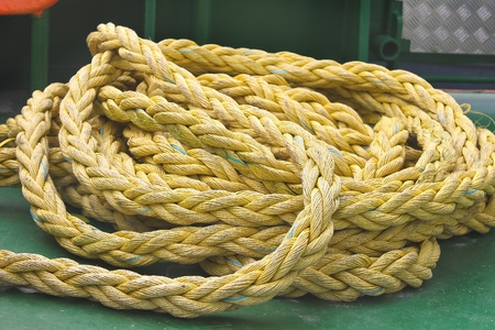 Marine rope on the deck of ship photo