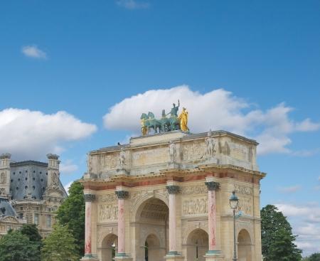 Triumphal Arch (Arc de Triomphe du Carrousel) at Tuileries. Paris, France photo