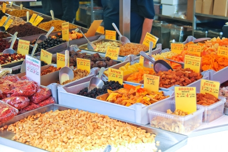 Sale of dried fruits and nuts on the market photo