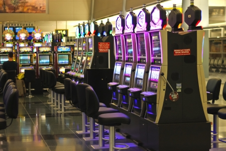 gambling counter: LAS VEGAS, NEVADA, USA - OCTOBER 20 : Slots in the airport McCarran on October 20, 2013 in Las Vegas, Nevada.  McCarran Airport has more than 1,234 slot machines throughout the airport terminals.