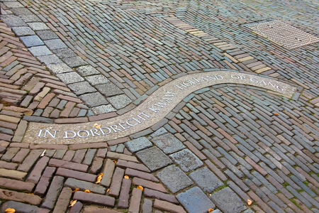 The inscription on the sidewalk in Dordrecht. Netherlands