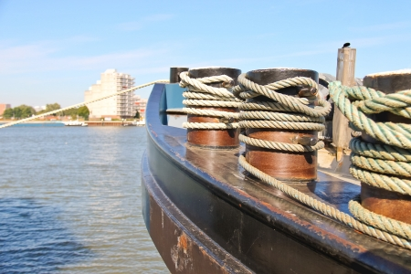 ship bow: Bow of the ship rope moored to the pier Stock Photo