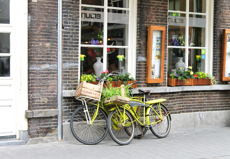 den: Two bicycle near the store. Den Bosch. Netherlands