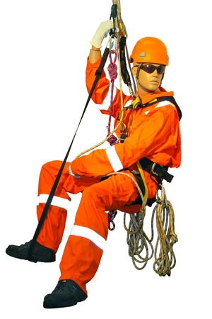 harness: Mannequin in overalls steeplejack on a white background Stock Photo