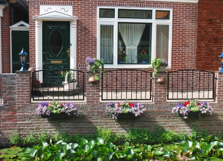 Flowers in front of the Dutch house. Netherlands