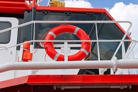 Lifebuoy on a modern ship photo