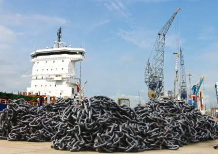 A pile of anchor chain at a shipyard photo