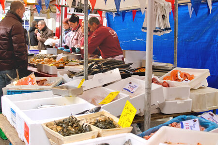 DELFT, THE NETHERLANDS - APRIL 7, 2012 : Selling seafood on the market in Delft, Netherlands