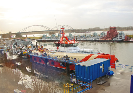GORINCHEM, THE NETHERLANDS - FEBRUARY 14, 2012 : New tugboats at a Dutch shipyard. Netherlands