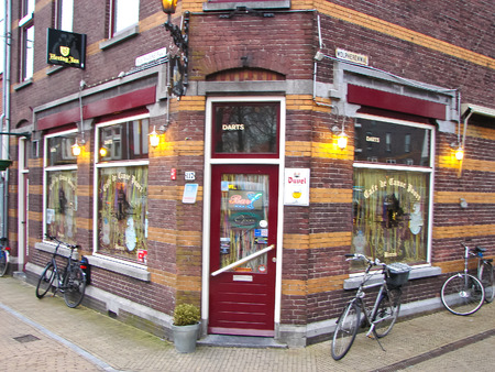 GORINCHEM, THE NETHERLANDS - FEBRUARY 16, 2012 : Bikes on the street outside a cafe in Gorinchem