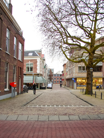 gorinchem: GORINCHEM, THE NETHERLANDS - FEBRUARY 16, 2012 : People walk in the Dutch town in Gorinchem. Netherlands.  The city is located in the province of South Holland. Population - about 33,000 people