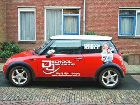 GORINCHEM, THE NETHERLANDS - FEBRUARY 17, 2012 :Advertisement on a car that stands in the street in Gorinchem. Netherlands  The city is located in the province of South Holland. Population - about 33,000 people Editorial