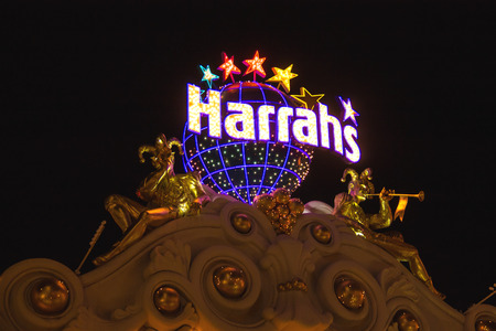 LAS VEGAS, NEVADA, USA - OCTOBER 23, 2013 : Harrah's Hotel and Casino Sign  in Las Vegas, Harrahs casino features over 1,200 slot machines, 80 table games, Keno, Bingo and a sports book.
