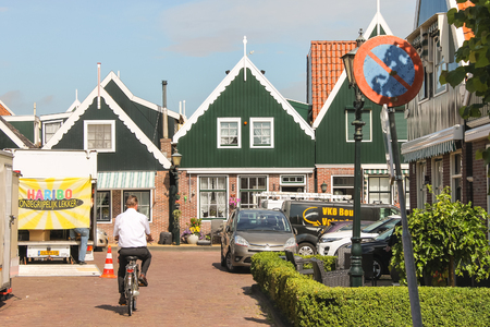 introduces: VOLENDAM,THE NETHERLANDS - JULY 7, 2012 : In the port  Volendam. Volendam is an international tourist attraction that introduces visitors to the life of the Dutch fishermen in the old days.