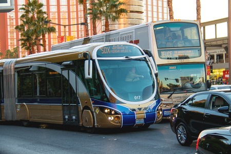 LAS VEGAS, NEVADA, USA - OCTOBER 25, 2013 : A regular and tourist buses in Las Vegas, Nevada. 40 million tourists visited Las Vegas in 2012
