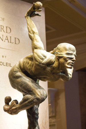 macdonald: LAS VEGAS, NEVADA, USA - OCTOBER 25, 2013 : Exhibition of statues Cirque du Soleil artists in Las Vegas. Over 50 bronze sculptures of R. MacDonald are exhibited in O Theatre lobby at Bellagio hotel.