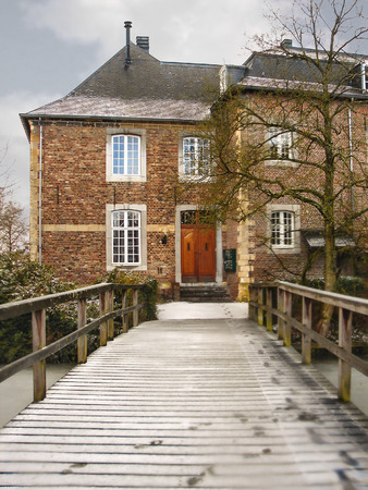 Winter in Holland. Old house during a snowfall photo