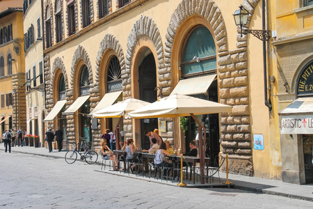 FLORENCE, ITALY - MAY 08, 2014: Tourists at an outdoor cafe in Florence. Italy