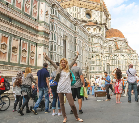 FLORENCE, ITALY - MAY 08, 2014: Tourists nearl Cathedral Santa Maria del Fiore. Florence, Italy