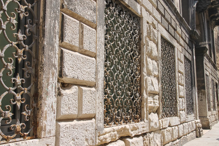 grates: Metal grates on the windows of the old houses in Venice, Italy