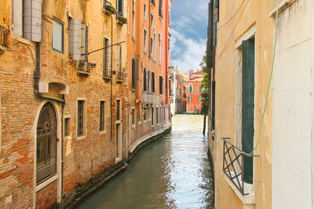 House on a narrow canal in Venice, Italy photo