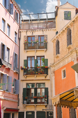 Picturesque Italian house with flowers on the balconies  photo