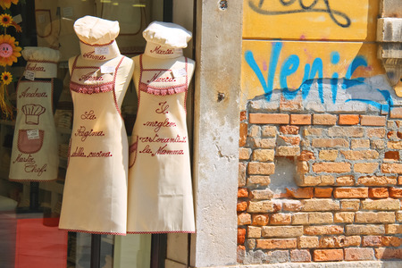 the merchant of venice: VENICE, ITALY - MAY 06, 2014: Sale of souvenir kitchen clothes in Venice, Italy
