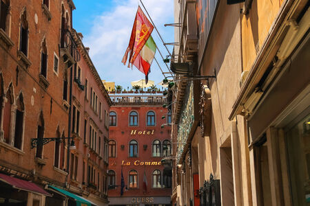 VENICE, ITALY - MAY 06, 2014: Flags of the European Union, Italy and Venice on a facade the building in Venice, Italy