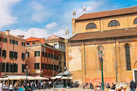 tent city: VENICE, ITALY - MAY 06, 2014:Tourists on the square near  Church Santa Maria Gloriosa dei Frari. Editorial