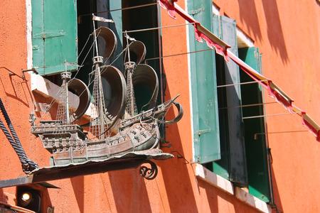 VENICE, ITALY - MAY 06, 2014: Model beautiful sailboat on a facade the house in Venice, Italy