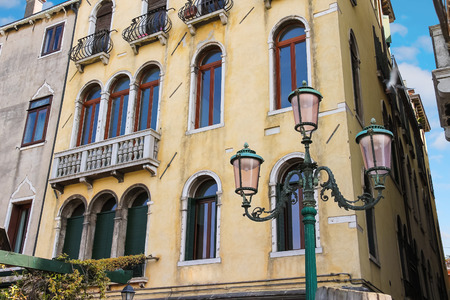 Lantern near a beautiful mansion in Venice, Italy photo