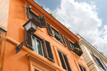 Picturesque Italian house with flowers on the windows