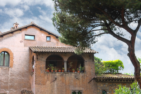 Picturesque Italian mansion under a pine tree