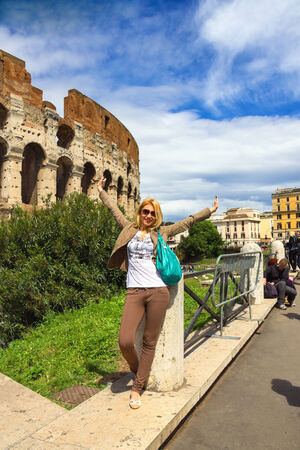 excursions: ROME, ITALY - MAY 04, 2014: Girl on excursions at the Colosseum. Rome, Italy